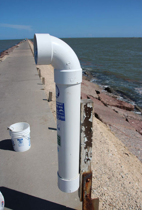 This is a monofilament bin located on the Surfside Jetty. You can recycle your fishing line in bins like this one.