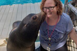 sheri posing with sea lion